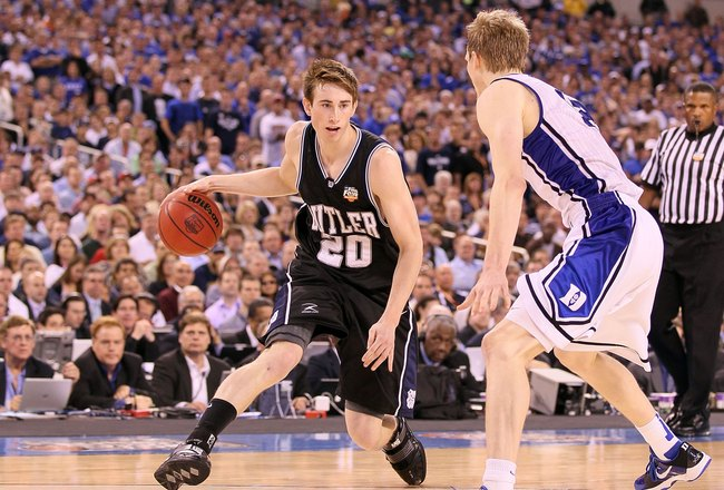 INDIANAPOLIS - APRIL 05:  Gordon Hayward #20 of the Butler Bulldogs drives against Kyle Singler #12 of the Duke Blue Devils during the 2010 NCAA Division I Men's Basketball National Championship game at Lucas Oil Stadium on April 5, 2010 in Indianapolis,