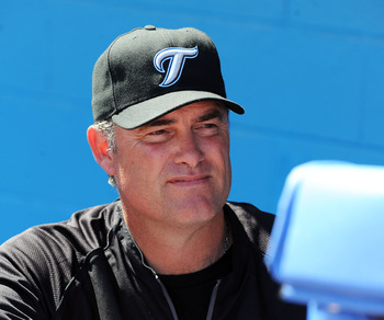 DUNEDIN, FL - FEBRUARY 26:  Manager John Farrell #52 of the Toronto Blue Jays watches play against the Detroit Tigers February 26, 2011 at Florida Auto Exchange Stadium in Dunedin, Florida.  (Photo by Al Messerschmidt/Getty Images)