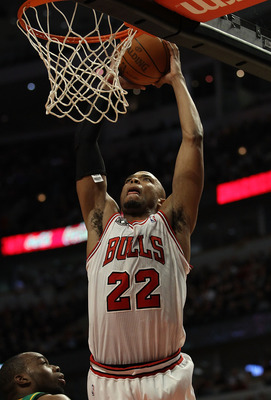 CHICAGO, IL - MARCH 07: Taj Gibson #22 of the Chicago Bulls goes up for a dunk against the New Orleans Hornets at the United Center on March 7, 2011 in Chicago, Illinois. The Bulls defeated the Hornets 85-77. NOTE TO USER: User expressly acknowledges and