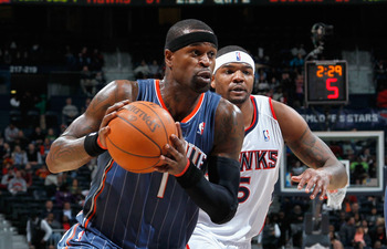ATLANTA, GA - FEBRUARY 12:  Stephen Jackson #1 of the Charlotte Bobcats drives past Josh Smith #5 of the Atlanta Hawks at Philips Arena on February 12, 2011 in Atlanta, Georgia.  NOTE TO USER: User expressly acknowledges and agrees that, by downloading an