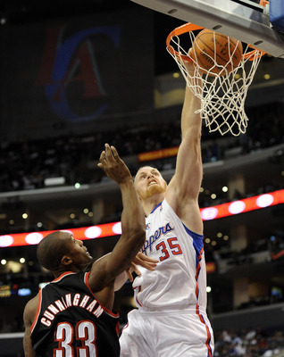 LOS ANGELES, CA - OCTOBER 27:  Chris Kaman #35 of the Los Angeles Clippers dunks over Dante Cunningham #33 of the Portland Trail Blazers during the first half at Staples Center on October 27, 2010 in Los Angeles, California. NOTE TO USER: User expressly a