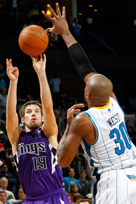 NEW ORLEANS, LA - DECEMBER 15:  Beno Udrih #19 of the Sacramento Kings shoots the ball over David West #30 of the New Orleans Hornets  at the New Orleans Arena on December 15, 2010 in New Orleans, Louisiana.  NOTE TO USER: User expressly acknowledges and