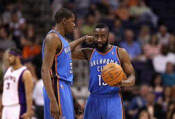 PHOENIX, AZ - MARCH 30:  Kevin Durant #35 and James Harden #13 of the Oklahoma City Thunder talk during the NBA game against the Phoenix Suns at US Airways Center on March 30, 2011 in Phoenix, Arizona. The Thunder defeated the Suns 116-98.   NOTE TO USER:
