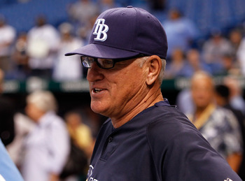 ST. PETERSBURG, FL - OCTOBER 12:  Manager Joe Maddon #70 of the Tampa Bay Rays talks with some reporters during batting practice before the start of Game 5 of the ALDS against the Texas Rangers at Tropicana Field on October 12, 2010 in St. Petersburg, Flo