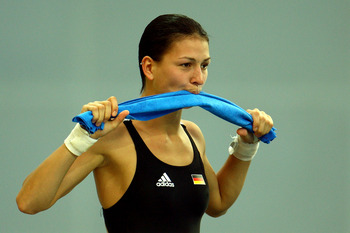 BEIJING - AUGUST 06:  Christin Steuer of Germany gestures like she is going to bite dowon on her towel ahead of the Beijing 2008 Olympics at the National Aquatics Center on August 6, 2008 in Beijing, China.  (Photo by Vladimir Rys/Getty Images)