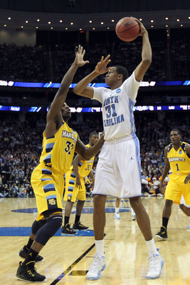 NEWARK, NJ - MARCH 25:  John Henson #31 of the North Carolina Tar Heels against Jae Crowder #32 of the Marquette Golden Eagles during the east regional semifinal of the 2011 NCAA Men's Basketball Tournament at the Prudential Center on March 25, 2011 in Ne