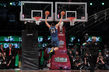 LOS ANGELES, CA - FEBRUARY 19:  JaVale McGee #34 of the Washington Wizards dunks two balls on the same jump in the first round of the Sprite Slam Dunk Contest apart of NBA All-Star Saturday Night at Staples Center on February 19, 2011 in Los Angeles, Cali