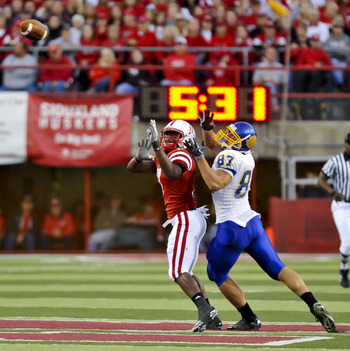 LINCOLN, NEBRASKA - SEPTEMBER 25: Nebraska Cornhuskers defensive back DeJon Gomes #7 and South Dakota State Jackrabbits tight end Colin Cochart #87 fight for position on the ball their game at Memorial Stadium on September 25, 2010 in Lincoln, Nebraska. N