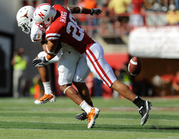 LINCOLN, NE - OCTOBER 16: Wide receiver Mike Davis #1 of the Texas Longhorns gets the ball knocked away by defensive back Eric Hagg #28 of the Nebraska Cornhuskers during first half action of their game at Memorial Stadium on October 16, 2010 in Lincoln,