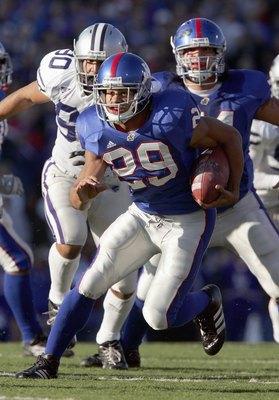 LAWRENCE, KS - NOVEMBER 18: Jon Cornish #29 of the Kansas Jayhawks carries the ball during the game against the Kansas State Wildcats at Memorial Stadium on November 18, 2006 in Lawrence, Kansas. The Kansas Jayhawks won 39-20. (Photo by Brian Bahr/Getty I