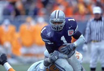 1 Jan 2001:  Josh Scobey #1 of the Kansas State Wildcats goes head to head against John Henderson #98 of the Tennessee Volunteers during the Cotton Bowl game in Dallas, Texas.  The Wildcats defeated the Volunteers 35-21.Mandatory Credit: Ronald Martinez