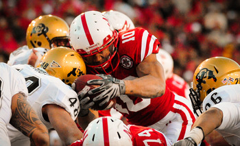 LINCOLN, NE - NOVEMBER 26: Roy Helu Jr. #10 of the Nebraska Cornhuskers dives for the endzone through the Colorado Buffaloes during their game at Memorial Stadium on November 26, 2010 in Lincoln, Nebraska. Nebraska defeated Colorado 45-17 (Photo by Eric F