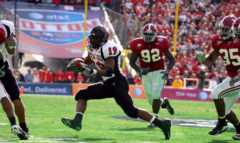 DALLAS - JANUARY 2:  Running back Taurean Henderson #19 of the Texas Tech Red Raiders runs the ball against the Alabama Crimson Tide during the AT&T Cotton Bowl on January 2, 2006 at the Cotton Bowl in Dallas, Texas. The Crimson Tide defeated the Red Raid