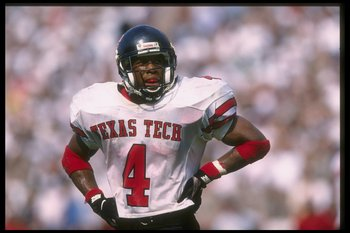 26 Oct 1996: Running back Byron Hanspard #4 of the Texas Tech Red Raiders looks to the sideline as he takes an opportunity to rest during a break in the action of the Red Raiders 13-10 victory over the Texas A&M Aggies at Lyons Field in College Station, T