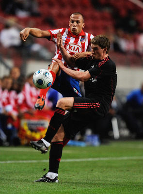 AMSTERDAM, NETHERLANDS - JULY 24:  Atletico Madrid's John Heitinga tackles Jan Vertonghen during the Amsterdam Tournament match between Ajax and Atletico Madrid at the Amsterdam Arena on July 24, 2009 in Amsterdam, Netherlands.  (Photo by Michael Regan/Ge