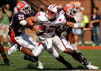 CHAMPAIGN, IL - OCTOBER 06: Justin Harrison #25 and Will Davis #81 of the Illinois Fighting Illini chase Quarterback Tyler Donovan #12 of the Wisconsin Badgers October 6, 2007 at Memorial Stadium in Champaign, Illinois.  (Photo by Matthew Stockman/Getty I
