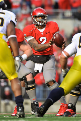 COLUMBUS, OH - NOVEMBER 27:  Quarterback Terrelle Pryor #2 of the Ohio State Buckeyes takes the snap from the center against the Michigan Wolverines at Ohio Stadium on November 27, 2010 in Columbus, Ohio.  (Photo by Jamie Sabau/Getty Images)