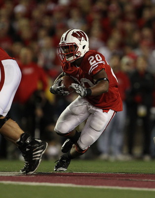 MADISON, WI - OCTOBER 16: James White #20 of the Wisconsin Badgers runs against the Ohio State Buckeyes at Camp Randall Stadium on October 16, 2010 in Madison, Wisconsin. Wisconsin defeated Ohio State 31-18. (Photo by Jonathan Daniel/Getty Images)