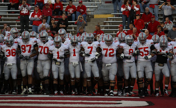 MADISON, WI - OCTOBER 16: Members of the Ohio State Buckeyes including Devon Torrence #1, Jermale Hines #7, Dexter Larimore #72 and Aaron Gant #8 walk on to the field for warm-ups before a game against the Wisconsin Badgers at Camp Randall Stadium on Octo