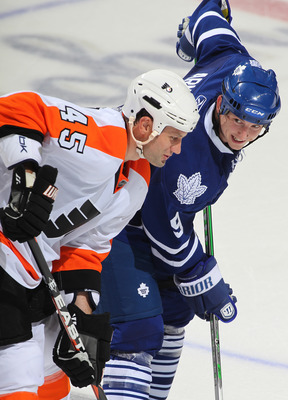 LONDON,ON - SEPTEMBER 23: Colby Armstrong #9 of the Toronto Maple Leafs has something funny to say to Jody Shelley #45 of the Philadelphia Flyers in a pre-season game on September 23,2010 at the John Labatt Centre in London, Ontario. The Leafs defeated th