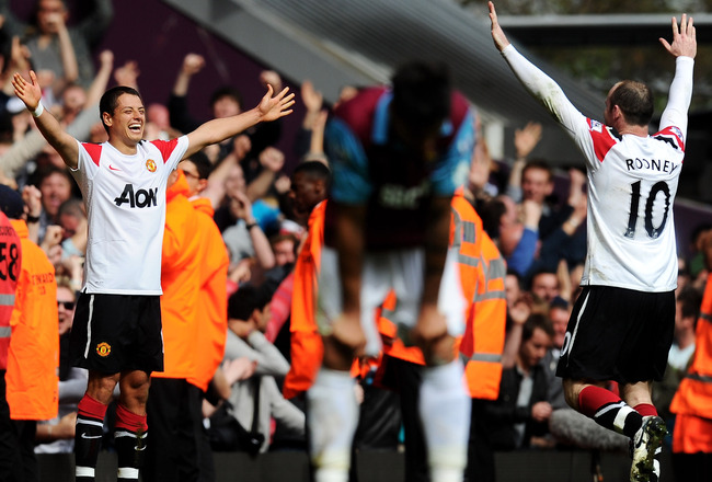 LONDON, ENGLAND - APRIL 02:  Javier Hernandez of Manchester United celebrates his goal with Wayne Rooney during the Barclays Premier League match between West Ham United and Manchester United at the Boleyn Ground on April 2, 2011 in London, England.  (Pho