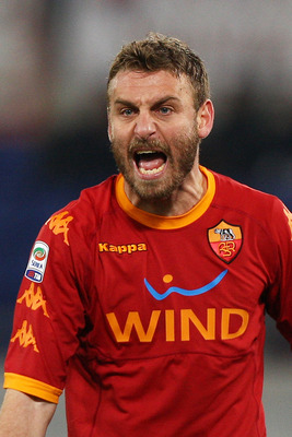 ROME, ITALY - FEBRUARY 02:  Daniele De Rossi of AS Roma reacts during the Serie A match between AS Roma and Brescia Calcio at Stadio Olimpico on February 2, 2011 in Rome, Italy.  (Photo by Paolo Bruno/Getty Images)