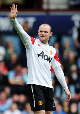 LONDON, ENGLAND - APRIL 02:  Wayne Rooney of Manchester United celebrates his hat trick during the Barclays Premier League match between West Ham United and Manchester United at the Boleyn Ground on April 2, 2011 in London, England.  (Photo by Mike Hewitt