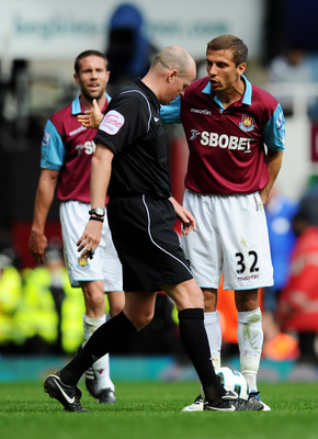 LONDON, ENGLAND - APRIL 02: Gary O'Neil of West Ham United talks to referee Lee Mason after he awarded a penalty to Manchester United during the Barclays Premier League match between West Ham United and Manchester United at the Boleyn Ground on April 2, 2