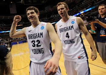 DENVER, CO - MARCH 19:  Jimmer Fredette #32 and Jackson Emery #4 of the Brigham Young Cougars walk off of the court after defeating the Gonzaga Bulldogs during the third round of the 2011 NCAA men's basketball tournament at Pepsi Center on March 19, 2011