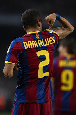 BARCELONA, SPAIN - MARCH 19:  Daniel Alves of Barcelona celebrates after scoring the opening goal during the La Liga match between Barcelona and Getafe at Camp Nou on March 19, 2011 in Barcelona, Spain.  (Photo by Manuel Queimadelos Alonso/Getty Images)