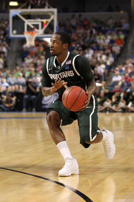 TAMPA, FL - MARCH 17:  Kalin Lucas #1 of the Michigan State Spartans drives against the UCLA Bruins during the second round of the 2011 NCAA men's basketball tournament at St. Pete Times Forum on March 17, 2011 in Tampa, Florida. UCLA won 78-76. (Photo by