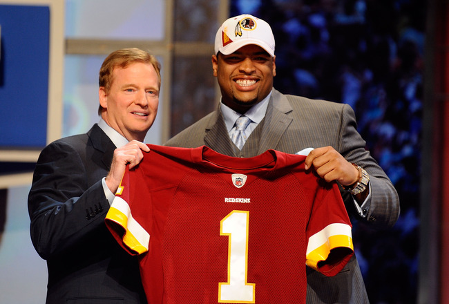 NEW YORK - APRIL 22:  Trent Williams (R) of the Oklahoma Sooners poses with NFL Commissoner Roger Goodell as they hold a Washington Redskins jersey after Washington selected Williams #4 overall during the 2010 NFL Draft at Radio City Music Hall on April 2