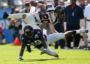 JACKSONVILLE, FL - JANUARY 01:  Danny Amendola #20 of the Texas Tech Red Raiders is tackled by  Ras-I Dowling #19 of the Virginia Cavaliers during the Gator Bowl at Jacksonville Municipal Stadium on January 1, 2008 in Jacksonville, Florida.  (Photo by Sam
