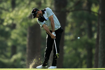 AUGUSTA, GA - APRIL 07:  Alvaro Quiros of Spain hits his approach shot on the 14th hole during the first round of the 2011 Masters Tournament at Augusta National Golf Club on April 7, 2011 in Augusta, Georgia.  (Photo by David Cannon/Getty Images)