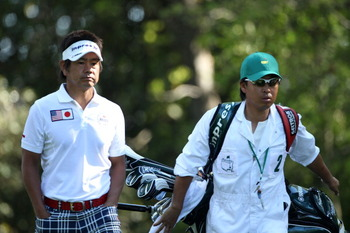 AUGUSTA, GA - APRIL 07:  Hiroyuki Fujita of Japan walks with his caddie Atsushi Umehara off the second tee during the first round of the 2011 Masters Tournament at Augusta National Golf Club on April 7, 2011 in Augusta, Georgia.  (Photo by Andrew Redingto