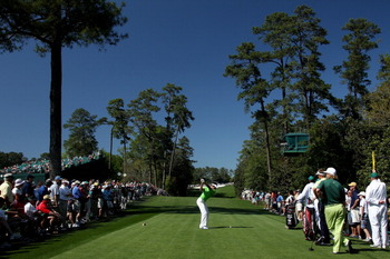 AUGUSTA, GA - APRIL 07:  (EDITORS NOTE: A POLARIZING FILTER WAS USED) Charl Schwartzel of South Africa hits his tee shot on the 18th green during the first round of the 2011 Masters Tournament at Augusta National Golf Club on April 7, 2011 in Augusta, Geo