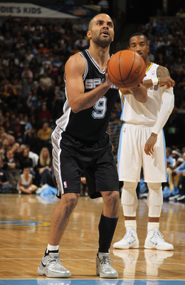 DENVER, CO - MARCH 23:  Tony Parker #9 of the San Antonio Spurs prepares to take a free throw against the Denver Nuggets at the Pepsi Center on March 23, 2011 in Denver, Colorado. The Nuggets defeated the Spurs 115-112. NOTE TO USER: User expressly acknow
