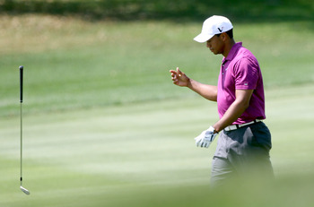 ORLANDO, FL - MARCH 26:  Tiger Woods tosses a club on the 5th hole during the third round of the Arnold Palmer Invitational presented by MasterCard at the Bay Hill Club and Lodge on March 26, 2011 in Orlando, Florida.  (Photo by Sam Greenwood/Getty Images