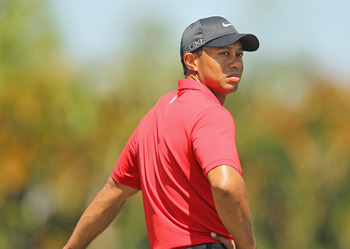 DORAL, FL - MARCH 13:  Tiger Woods waits on a tee box during the final round of the 2011 WGC- Cadillac Championship at the TPC Blue Monster at the Doral Golf Resort and Spa on March 13, 2011 in Doral, Florida.  (Photo by Mike Ehrmann/Getty Images)