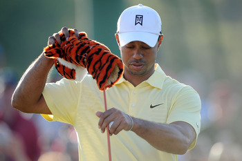 AUGUSTA, GA - APRIL 06:  Tiger Woods pulls his driver from his golf bag during a practice round prior to the 2010 Masters Tournament at Augusta National Golf Club on April 6, 2010 in Augusta, Georgia.  (Photo by Harry How/Getty Images)