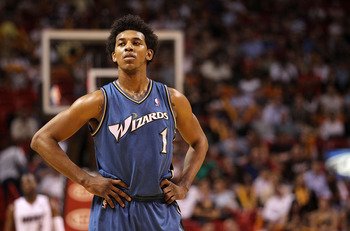 MIAMI, FL - FEBRUARY 25:  Nick Young #1 of the  Washington Wizards looks on during a pause in the game against the Miami Heat  at American Airlines Arena on February 25, 2011 in Miami, Florida. NOTE TO USER: User expressly acknowledges and agrees that, by