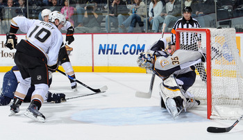 NASHVILLE, TN - MARCH 24: Corey Perry #10 of the Anaheim Ducks watches a puck shot by teammate Teemu Selanne #8 get past Pekka Rinne #35 of the Nashville Predators for a goal on March 24, 2011 at the Bridgestone Arena in Nashville, Tennessee.  (Photo by F