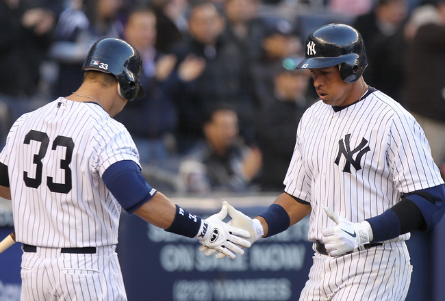 NEW YORK, NY - APRIL 02:  Alex Rodriguez #13 of the New York Yankees celebrates his solo homerun with teammate Nick Swisher #33 against the Detroit Tigers at Yankee Stadium on April 2, 2011 in the Bronx borough of New York City.  (Photo by Nick Laham/Gett