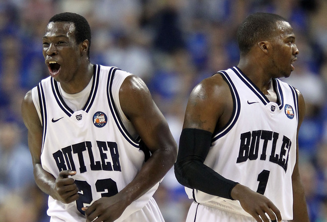 HOUSTON, TX - APRIL 02:  Khyle Marshall #23 of the Butler Bulldogs reacts alongside teammate Shelvin Mack #1 in the first half while taking on Virginia Commonwealth Rams during the National Semifinal game of the 2011 NCAA Division I Men's Basketball Champ