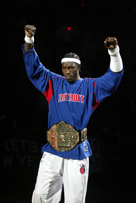 AUBURN HILLS, MI - NOVEMBER 2:  Ben Wallace #3 of the Detroit Pistons raises his arms after being introduced to a sellout crowd as the NBA defending champion Detroit Pistons hold a pregame ceremony before their game against the Houston Rockets on November