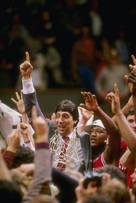 4 Apr 1983: Head coach Jim Valvano of the North Carolina State Wolfpack celebrates with his team after the Wolfpack defeated the Houston Cougars 54-52 in the NCAA men''s basketball championship game at University Arena in Albuquerque, New Mexico.