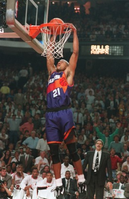 18 JUN 1993:  RICHARD DUMAS, FORWARD FOR THE PHOENIX SUNS, DUNKS THE BALL DURING GAME 5 OF THE NBA FINALS AGAINST THE CHICAGO BULLS AT CHICAGO STADIUM IN CHICAGO, ILLINOIS. Mandatory Credit: Jonathan Daniel/ALLSPORT