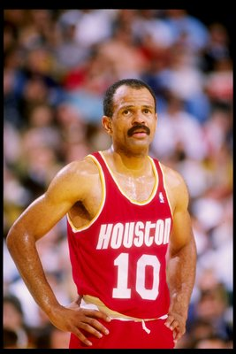 1990:  John Lucas of the Houston Rockets looks on during a game against the Los Angeles Lakers at the Great Western Forum in Inglewood, California. Mandatory Credit: Ken Levine  /Allsport