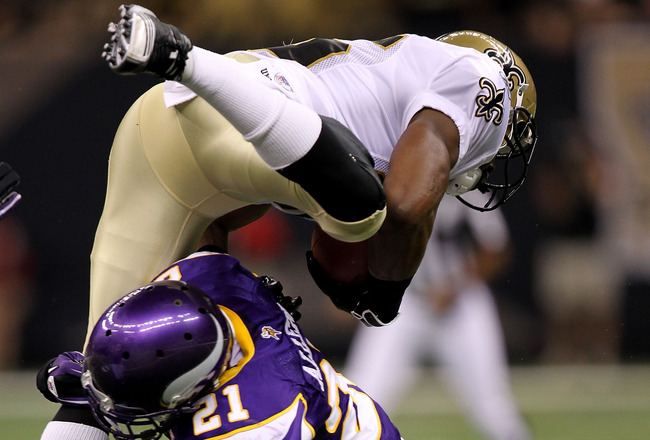 NEW ORLEANS - SEPTEMBER 09:  Reggie Bush #25 of the New Orleans Saints is tackled by Asher Allen #21 of the Minnesota Vikings at Louisiana Superdome on September 9, 2010 in New Orleans, Louisiana.  (Photo by Ronald Martinez/Getty Images)