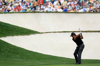Mickelson hitting over the bunkers on 5th